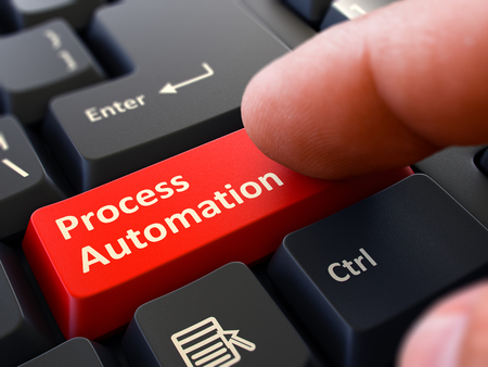 computerization: Process Automation Button. Male Finger Clicks on Red Button on Black Keyboard. Closeup View. Blurred Background. 3D Render.