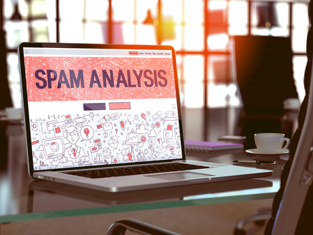 spammer: Modern Workplace with Laptop Showing Landing Page in Doodle Design Style with Text Spam Analysis. Toned Image with Selective Focus. 3D Render.