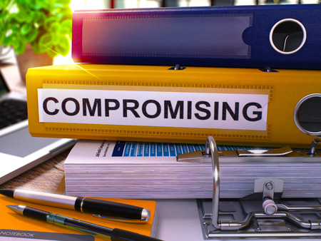 extortion: Compromising - Yellow Office Folder on Background of Working Table with Stationery and Laptop. Compromising Business Concept on Blurred Background. Compromising Toned Image. 3D.