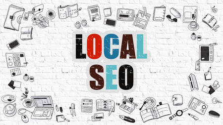 brickwall: Local SEO, Local Search Engine Optimization. Multicolor Inscription on White Brick Wall with Doodle Icons Around. Local SEO on White Brickwall Background.