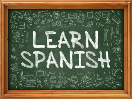polyglot: Learn Spanish - Hand Drawn on Green Chalkboard with Doodle Icons Around. Modern Illustration with Doodle Design Style.