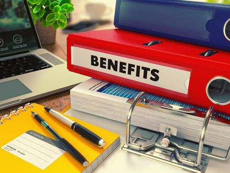 benefits: Red Office Folder with Inscription Benefits on Office Desktop with Office Supplies and Modern Laptop. Business Concept on Blurred Background. Toned Image. 3d Render. Stock Photo
