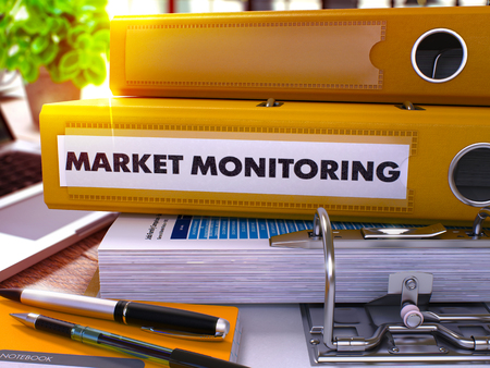 stationery needs: Market Monitoring - Yellow Office Folder on Background of Working Table with Stationery and Laptop. Market Monitoring Business Concept on Blurred Background. Market Monitoring Toned Image. 3D.