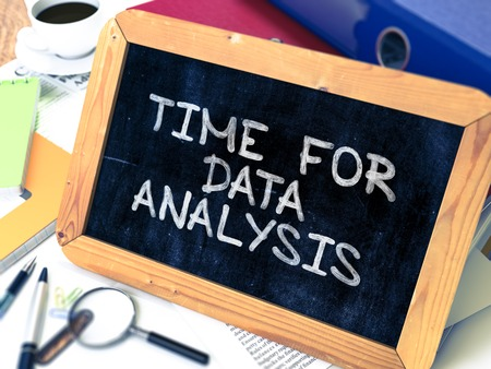 stationery needs: Time for Data Analysis - Chalkboard with Hand Drawn Text, Stack of Office Folders, Stationery, Reports on Blurred Background. Toned Image. 3D Render. Stock Photo