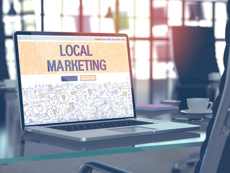 Local Marketing Concept. Closeup Landing Page on Laptop Screen in Doodle Design Style. On Background of Comfortable Working Place in Modern Office. Blurred, Toned Image. 3D Render. Foto de archivo