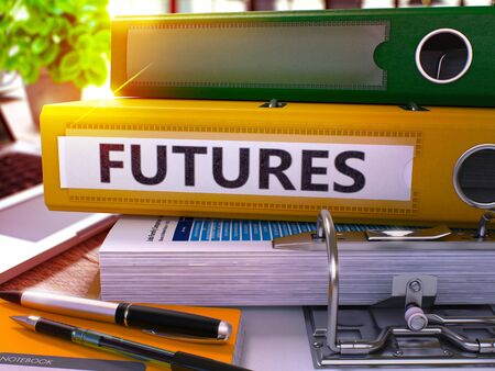 futures: Futures - Yellow Office Folder on Background of Working Table with Stationery and Laptop. Futures Business Concept on Blurred Background. Futures Toned Image. 3D.