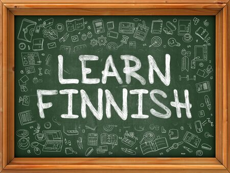 polyglot: Learn Finnish - Handwritten Inscription by Chalk on Green Chalkboard with Doodle Icons Around. Modern Style with Doodle Design Icons. Learn Finnish on Background of Green Chalkboard with Wood Border.
