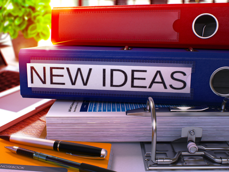 new ideas: Blue Office Folder with Inscription New Ideas on Office Desktop with Office Supplies and Modern Laptop. New Ideas Business Concept on Blurred Background. New Ideas - Toned Image. 3D.