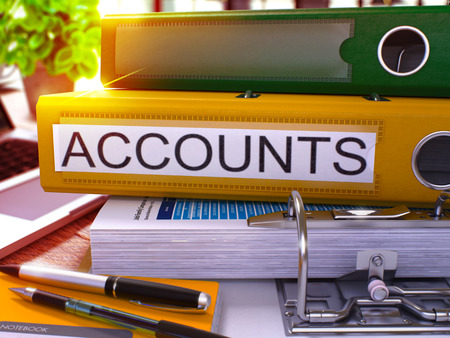remuneraciones: Yellow Office Folder with Inscription Accounts on Office Desktop with Office Supplies and Modern Laptop. Accounts Business Concept on Blurred Background. Accounts - Toned Image. 3D Render.