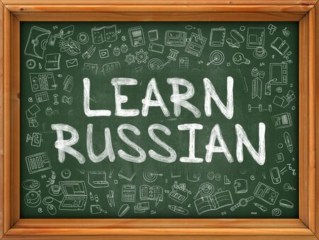 polyglot: Green Chalkboard with Hand Drawn Learn Russian with Doodle Icons Around. Line Style Illustration. Stock Photo