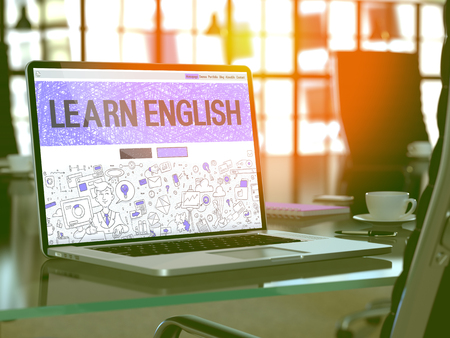place to learn: Learn English Concept. Closeup Landing Page on Laptop Screen in Doodle Design Style. On Background of Comfortable Working Place in Modern Office. Blurred, Toned Image. 3D Render.