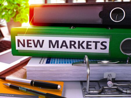 competitividad: Green Office Folder with Inscription New Markets on Office Desktop with Office Supplies and Modern Laptop. New Markets Business Concept on Blurred Background. New Markets - Toned Image. 3D.