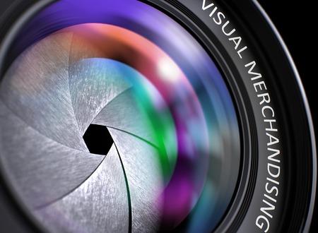 Primer punto de vista. Lente de la cámara con la inscripción de Visual Merchandising. Destellos de lente de colores en el vidrio frontal. Render 3D.