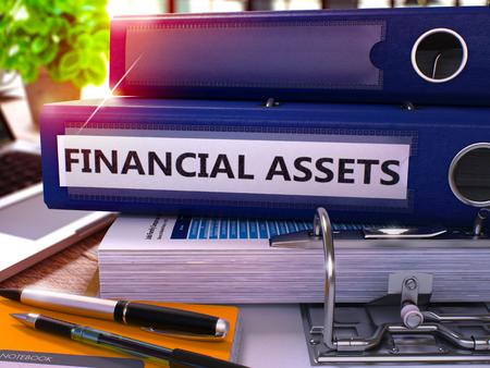 financial assets: Blue Office Folder with Inscription Financial Assets on Office Desktop with Office Supplies and Modern Laptop. Financial Assets Business Concept on Blurred Background. 3D Render.