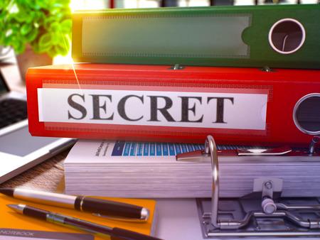 undisclosed: Secret - Red Ring Binder on Office Desktop with Office Supplies and Modern Laptop. Secret Business Concept on Blurred Background. Secret - Toned Illustration. 3D Render. Stock Photo