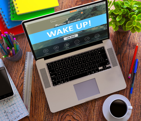 wakening: Wake Up Concept. Modern Laptop and Different Office Supply on Wooden Desktop background. 3D Render. Stock Photo