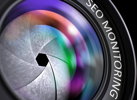 rewriting: Colored Lens Reflections Closeup on Digital Camera Lens with Inscription SEO Monitoring. Stock Photo