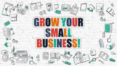 small business: Grow Your Small Business Drawn on White Brick Wall. Stock Photo
