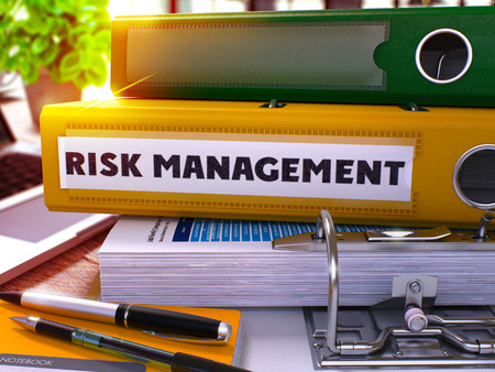 financial diversification: Risk Management - Yellow Ring Binder on Office Desktop with Office Supplies and Modern Laptop. Risk Management Business Concept on Blurred Background. Risk Management - Toned Illustration. 3D Render.
