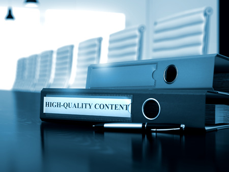 rewriting: High-Quality Content. Business Illustration on Blurred Background. Office Folder with Inscription High-Quality Content on Office Desk. High-Quality Content - File Folder on Desktop. Toned Image. 3D.