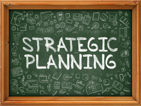 planning: Green Chalkboard with Hand Drawn Strategic Planning with Doodle Icons Around. Line Style Illustration. Stock Photo