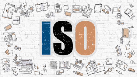 standardization: ISO - International Organization Standardization. Multicolor Inscription on White Brick Wall with Doodle Icons Around. Modern Style Illustration with Doodle Design Icons. ISO on Brickwall Background.