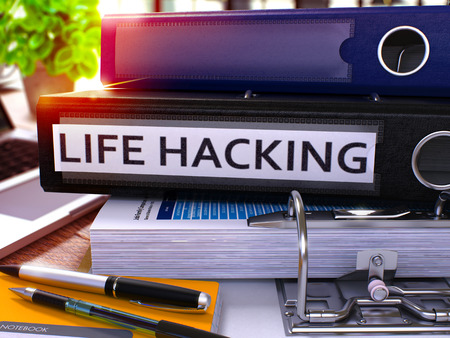 mnemonic: Black Office Folder with Inscription Life Hacking on Office Desktop with Office Supplies and Modern Laptop. Life Hacking Business Concept on Blurred Background. Life Hacking - Toned Image. 3D.