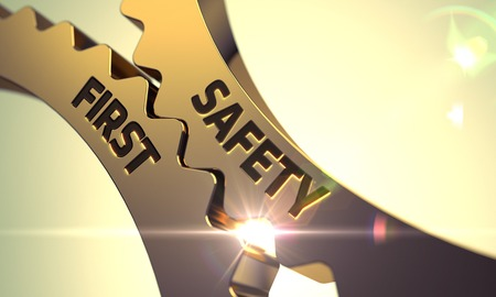 safety first: Safety First on the Mechanism of Golden Gears with Glow Effect. Safety First - Illustration with Glowing Light Effect. Golden Cogwheels with Safety First Concept. 3D. Stock Photo