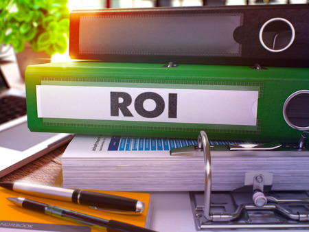 coefficient: Green Office Folder with Inscription ROI - Return on Investment - on Office Desktop with Office Supplies and Modern Laptop. ROI Business Concept on Blurred Background. ROI- Toned Image. 3D Stock Photo