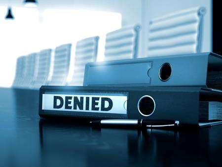 negate: Denied - Business Concept on Toned Background. Denied. Illustration on Blurred Background. Denied - Ring Binder on Wooden Desk. Office Folder with Inscription Denied on Wooden Desktop. 3D Toned Image.