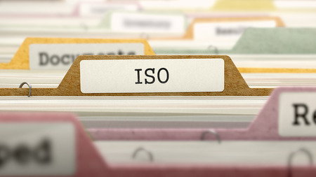 standardization: ISO - International Organization Standardization - Folder Register Name in Directory. Colored, Blurred Image. Closeup View. 3D Render.