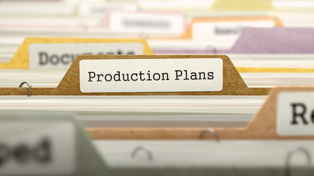 marked: Folder in Colored Catalog Marked as Production Plans Closeup View. Selective Focus. 3D Render. Stock Photo