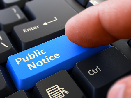 a public notice: Public Notice Button. Male Finger Clicks on Blue Button on Black Keyboard. Closeup View. Blurred Background. 3D Render.