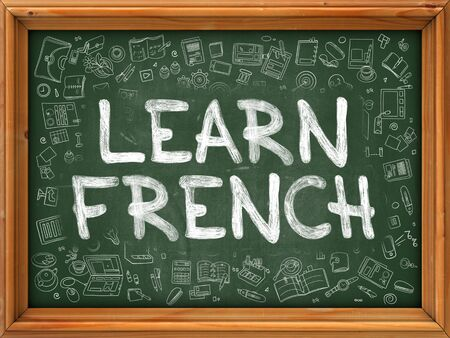 polyglot: Green Chalkboard with Hand Drawn Learn French with Doodle Icons Around. Line Style Illustration. Stock Photo