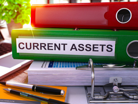 Current Assets - Green Office Folder on Background of Working Table with Stationery and Laptop. Current Assets Business Concept on Blurred Background. Current Assets Toned Image. 3D.