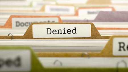 disclaim: Denied on Business Folder in Multicolor Card Index. Closeup View. Blurred Image. 3D Render.