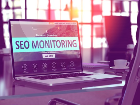 SEO Monitoring Concept. Closeup Landing Page on Laptop Screen  on background of Comfortable Working Place in Modern Office. Blurred, Toned Image. 3D Render. Stock Photo