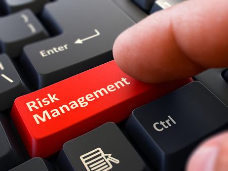 minimization: Computer User Presses Red Button Risk Management on Black Keyboard. Closeup View. Blurred Background. 3D Render.