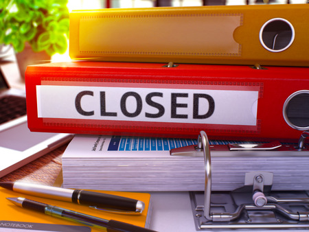 closed business: Red Ring Binder with Inscription Closed on Background of Working Table with Office Supplies and Laptop. Closed - Toned Illustration. Closed Business Concept on Blurred Background. 3D Render.