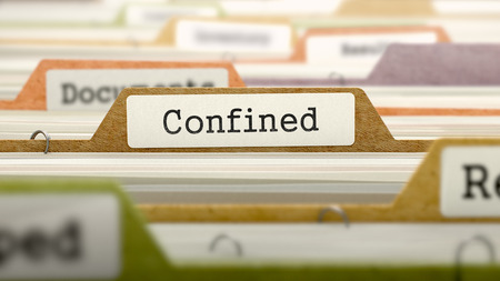 confined: Confined on Business Folder in Multicolor Card Index. Closeup View. Blurred Image.
