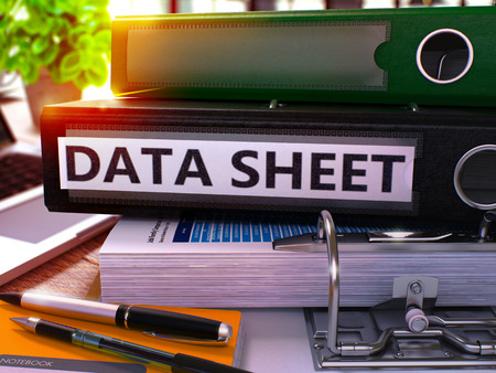 data sheet: Data Sheet - Black Office Folder on Background of Working Table with Stationery and Laptop. Data Sheet Business Concept on Blurred Background. Data Sheet Toned Image. 3D.