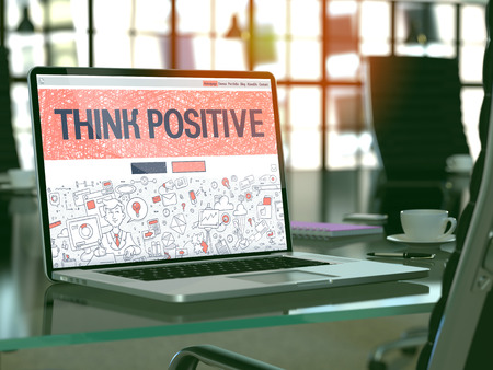 positivismo: Think Positive Concept. Closeup Landing Page on Laptop Screen in Doodle Design Style. On Background of Comfortable Working Place in Modern Office. Blurred, Toned Image. 3D Render. Foto de archivo