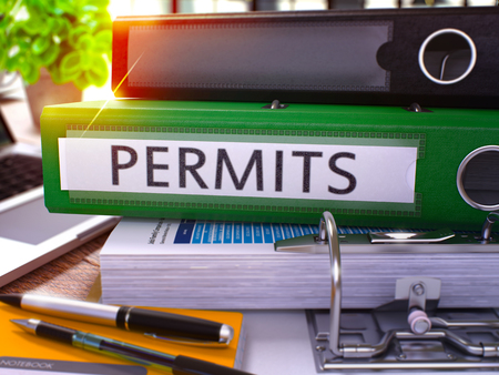 permits: Permits - Green Office Folder on Background of Working Table with Stationery and Laptop. Permits Business Concept on Blurred Background. Permits Toned Image. 3D.