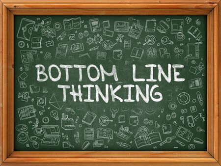 at the bottom of: Bottom Line Thinking - Hand Drawn on Chalkboard. Bottom Line Thinking with Doodle Icons Around. Stock Photo