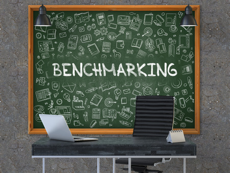 collate: Green Chalkboard on the Dark Old Concrete Wall in the Interior of a Modern Office with Hand Drawn Benchmarking. Business Concept with Doodle Style Elements. 3D. Stock Photo