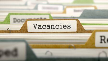 vacancies: Folder in Colored Catalog Marked as Vacancies Closeup View. Selective Focus. 3D Render.
