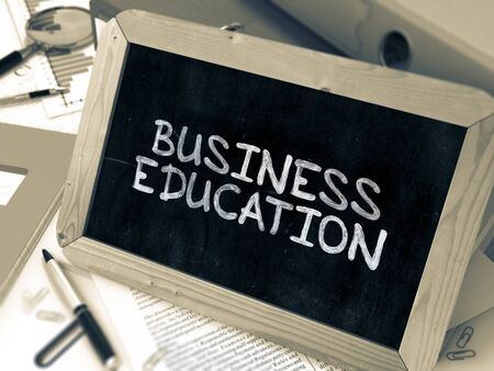 competencies: Business Education - Chalkboard with Hand Drawn Text, Stack of Office Folders, Stationery, Reports on Blurred Background. Toned Image. 3D Render. Stock Photo