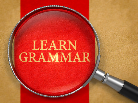 grammar: Learn Grammar Concept through Magnifier on Old Paper with Red Vertical Line Background. 3D Render. Stock Photo