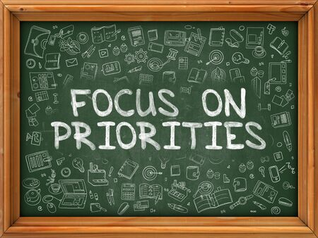 priorities: Focus on Priorities - Hand Drawn on Green Chalkboard with Doodle Icons Around. Modern Illustration with Doodle Design Style.