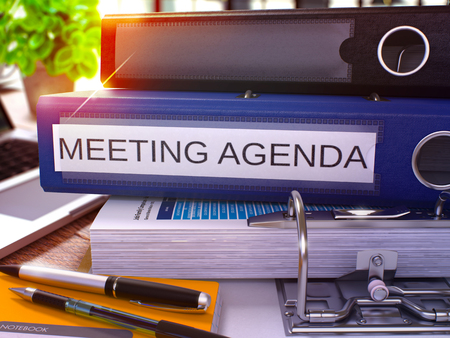 meeting agenda: Meeting Agenda - Blue Ring Binder on Office Desktop with Office Supplies and Modern Laptop. Meeting Agenda Business Concept on Blurred Background. Meeting Agenda - Toned Illustration. 3D Render.